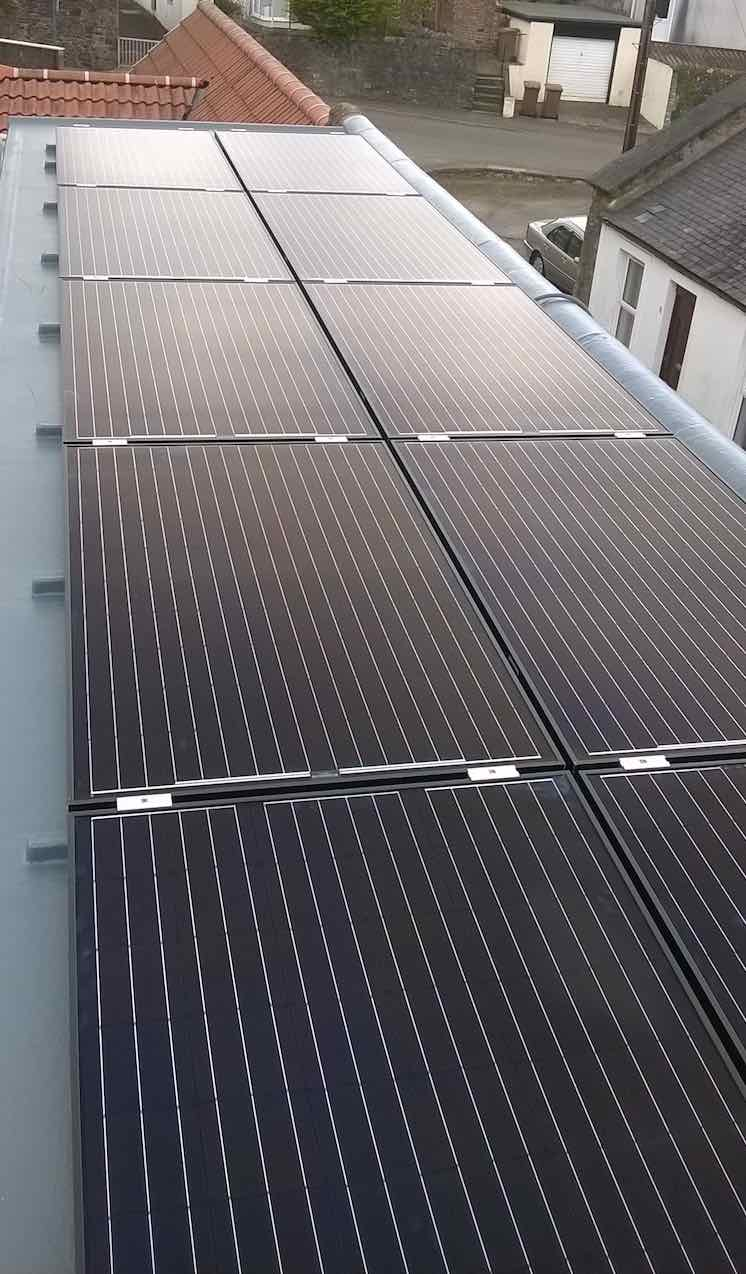 Solar panels flat roof installation. These contribute significantly to the firing of the kiln at Butter Wynd Pottery